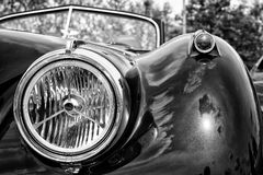 Headlamp sports car Jaguar XK140 Roadster, (black and white) Royalty Free Stock Photo