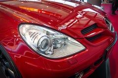Headlamp of a sports car Mercedes-Benz SLK 200 Kompressor (R171), 2006. Stock Images