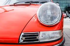 Headlamp of sports car Porsche 911, 1970. Close-up. Stock Photos