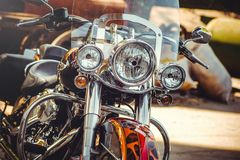 Headlamps of a classic motorcycle, beautiful artistic processing for flyer calendar and advertising.  royalty free stock photo