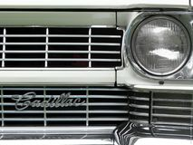 Headlamps on a green vintage Cadillac car royalty free stock images
