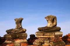 Headless Buddha ruins at the temple in Ayutthaya. Headless Buddha ruins at the temple of Wat Chai Wattanaram in Ayutthaya near Bangkok, Thailand Royalty Free Stock Image