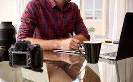Headless crop of a photographer at his home workspace Stock Image