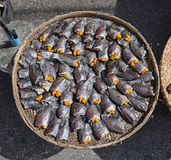Headless dried fish called Pla Salit on round bamboo basket Royalty Free Stock Photography