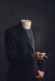 Headless man with ashtray smoking a cigarette Royalty Free Stock Photo