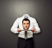 Headless man holding head on white plate Stock Photography