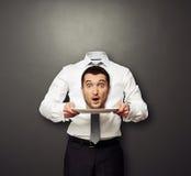 Headless man holding surprised head Stock Image