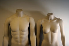 Headless mannequin dummies. Headless male and female mannequin shop window dummies, studio background royalty free stock image