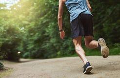 Headless Rear View Shot of Man Running at the Park Stock Photos