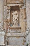 A headless statue adorns the front of the celebrated library at Ephesus Stock Photos