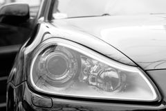Headlight. Close up of a modern auto headlight Royalty Free Stock Photo