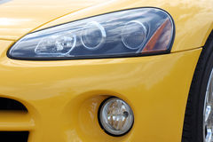 Headlight. Of yellow racing car Royalty Free Stock Photography
