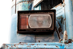 Headlight of abandoned bus. Royalty Free Stock Photo