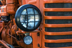 The headlight of abandoned rusty vintage tractor. Small depth of field Royalty Free Stock Image