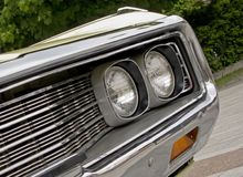Headlight of american muscle car Royalty Free Stock Images
