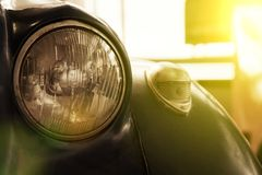 Headlight of antique old car, detail on the headlight of a vintage car. Selective focus royalty free stock photos