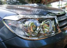 The headlight of automobile SUV Royalty Free Stock Photography
