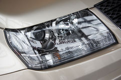 Headlight on a beige car Royalty Free Stock Images