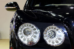 Headlight of blue Bentley series Flying Spur W12  luxury  car Stock Image