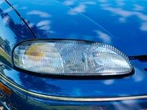 Headlight on blue car Royalty Free Stock Photos