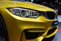 Headlight of BMW M4 Coupe. BANGKOK - MARCH 28 : Headlight of BMW M4 Coupe on display at The 38th Bangkok International Motor Show : Reach to The Planet of Stock Photography
