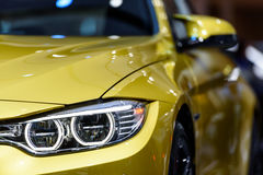Headlight of BMW M4 Coupe. Royalty Free Stock Photos