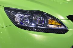 Headlight bumper of green sport car Royalty Free Stock Images