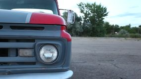 Headlight and bumper of old American car. stock footage
