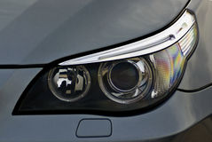 Headlight of a car. The front headlight of a car Royalty Free Stock Images