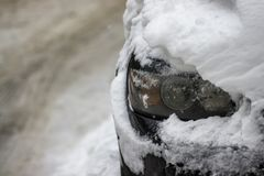 Headlight car covered with snow, Frost, winter, snow royalty free stock photos