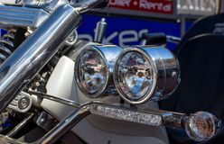 Headlight closeup of powerful motorcycle.  Stock Photography
