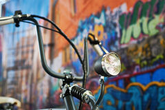 Headlight custom bike closeup. On graffiti background royalty free stock photography