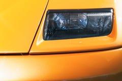 Headlight design on a yellow sports car. Headlight design on a luxury yellow sports car Royalty Free Stock Photo