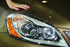 Headlight detail. Of a modern coupe and a beautiful hand Royalty Free Stock Images