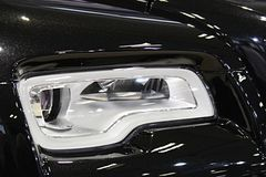Headlight detail of modern luxurious english limousine stock photos