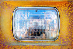 Headlight. Detail of headlight on an old yellow car Royalty Free Stock Photo
