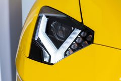 Headlight detail on sports car, Lamborghini Aventador S coupe. Standing at Volkswagen Group forum Drive in Berlin, Germany Stock Image
