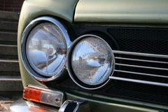 Headlight and direction indicator of a vintage car Stock Image