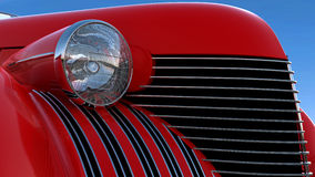 Headlight and engine jacket of red retro car Stock Image