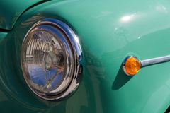 Headlight and Flashing signal of Classic Car. Headlamp front car and flashing orange light in green Classic Car Royalty Free Stock Photography