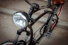 Headlight on the frame of the bike. stock images