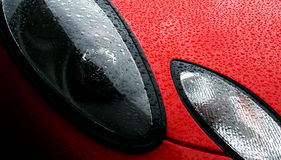 Headlight of a freshly waxed sports car Stock Photo