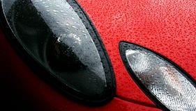 Headlight of a freshly waxed sports car Stock Photo