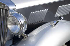 Headlight and front cover on english retro car Royalty Free Stock Images