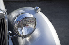 Headlight and front cover on english retro car Royalty Free Stock Photography