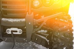 Headlight and front part of the `Russian Mechanics` ATV, color green, winter,. Holiday `Seeing the winter royalty free stock image