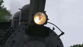 Headlight on the front of a train stock video
