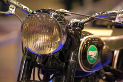 Headlight and fuel tank of old motorbike closeup Royalty Free Stock Photography