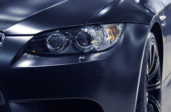 Headlight of a German sports car Stock Photos