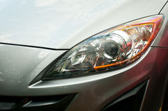 Headlight of grey car Royalty Free Stock Images